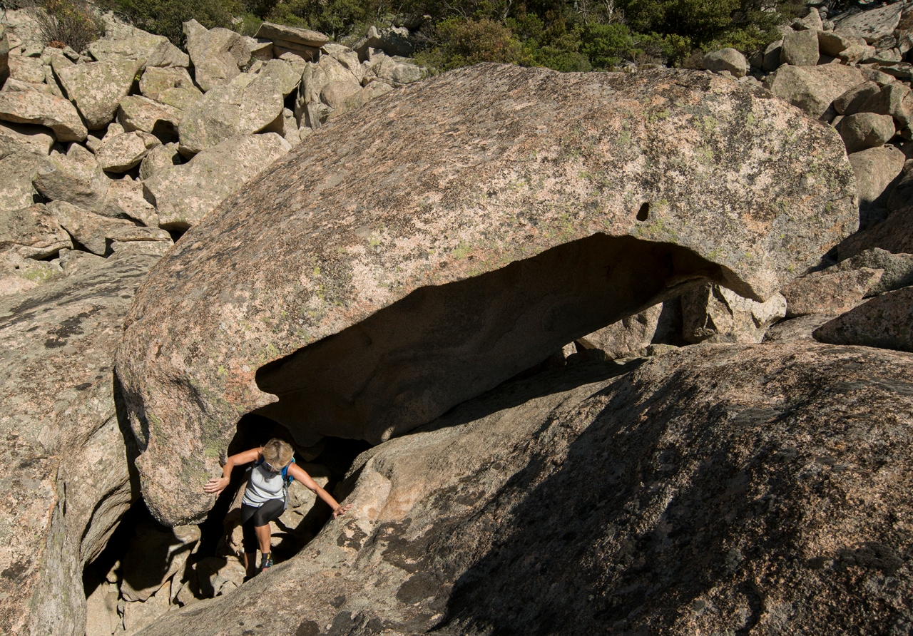 Hiker among granite boulders